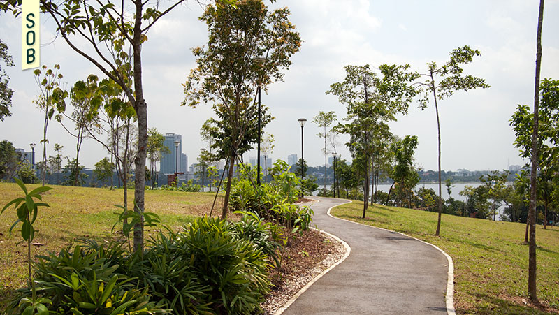 The rolling greens of Woodlands Waterfront Park with views of Malaysia
