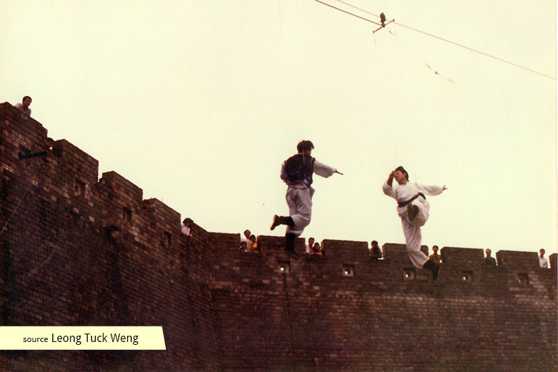 Duelling ancient swordsmen on cables at Tang Dynasty City