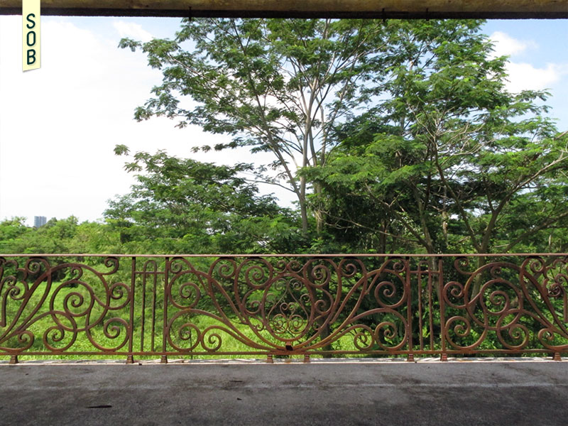 Metal floral patterns of Istana Woodneuk juxtaposed with lush greenery of the Botanic Gardens area