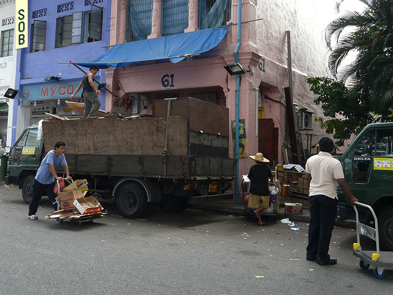 Workers load a lorry with cardboard at Dickson Road, Singapore