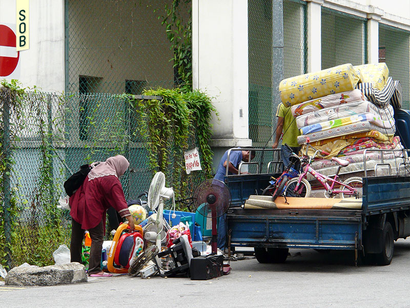 Used goods laid out on the streets of Dickson Road