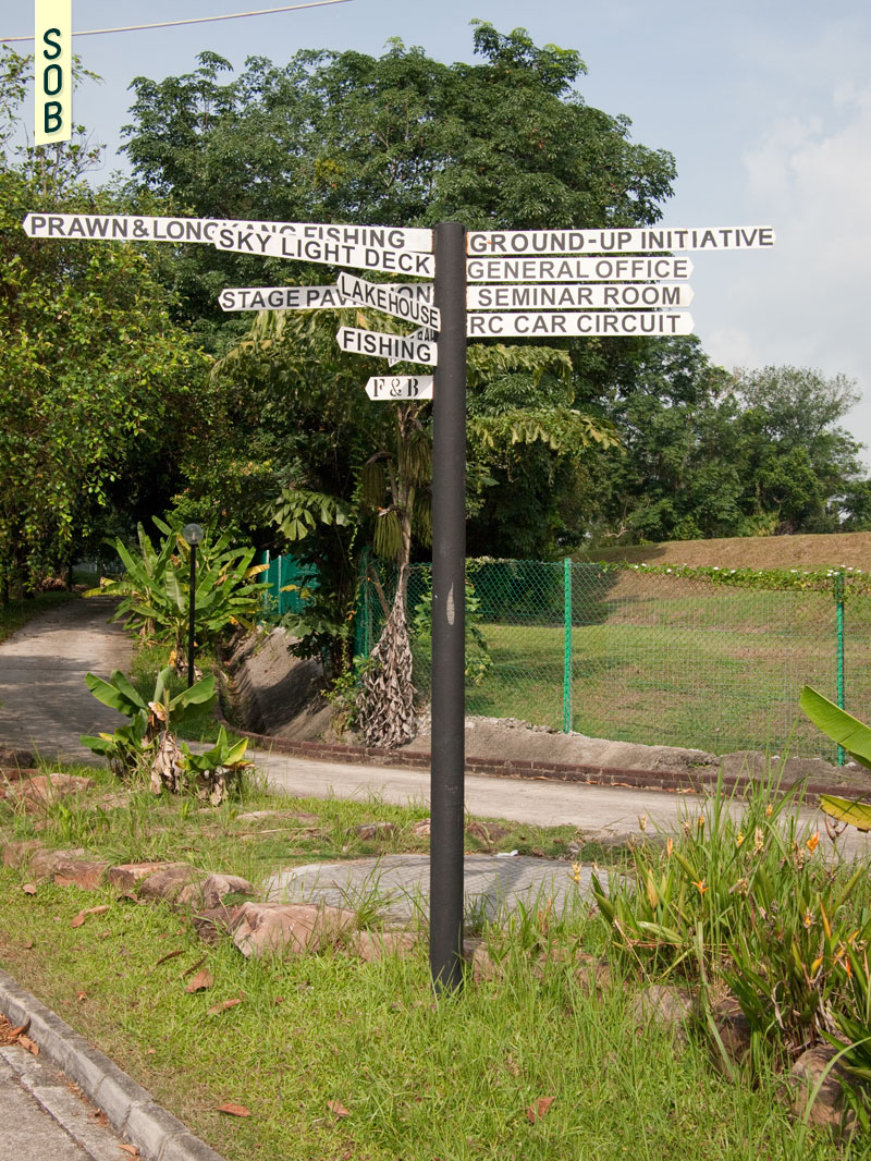 Directional signboard at Bottle Tree Park