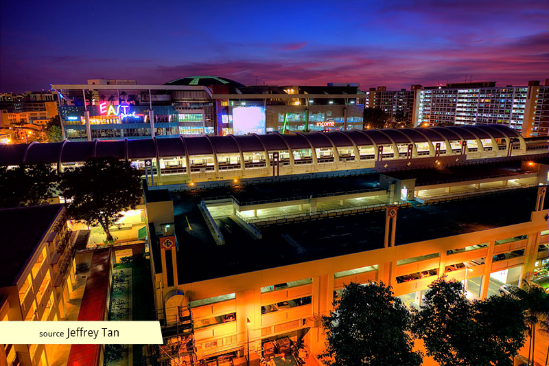 Eastpoint Mall and Simei MRT Station at night
